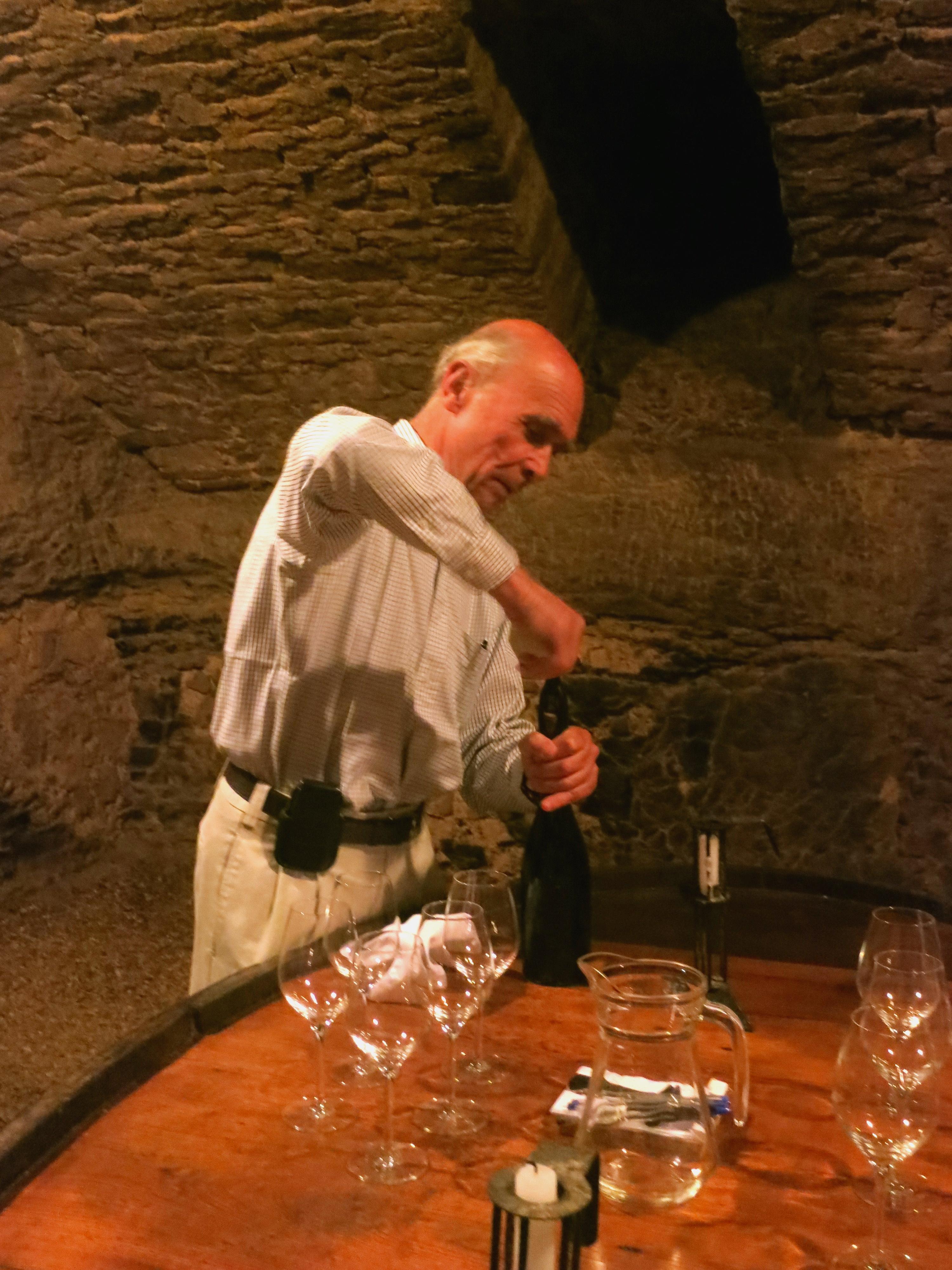 Aubert de Villaine prepares for a tasting in the cellars of the Domaine de la Romanée-Conti ©Sylvia Davis