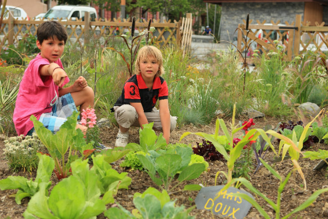 kids planting a vegetable garden in Les Gets