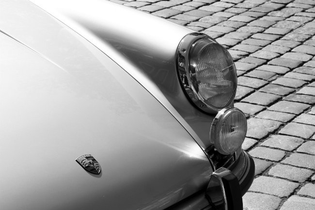"Detail of a Porsche 911 car, from the film ""Le Départ"". Photo: AngMoKio"