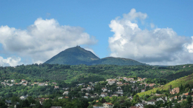 The city's skyline is dominated by the Puy de Dome, one of the extinct volcanoes in France's Massif Central. Photo © 2016, Richard L. Alexander