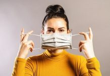 Woman wearing an anti virus protection mask to prevent others from corona COVID-19 and SARS cov 2 infection R