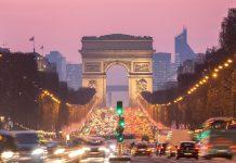 Paris Arc of Triomphe along Champs-Elysees France sunset