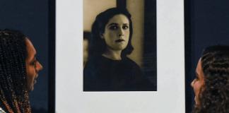 Tate modern staff examining Dora Maar painting