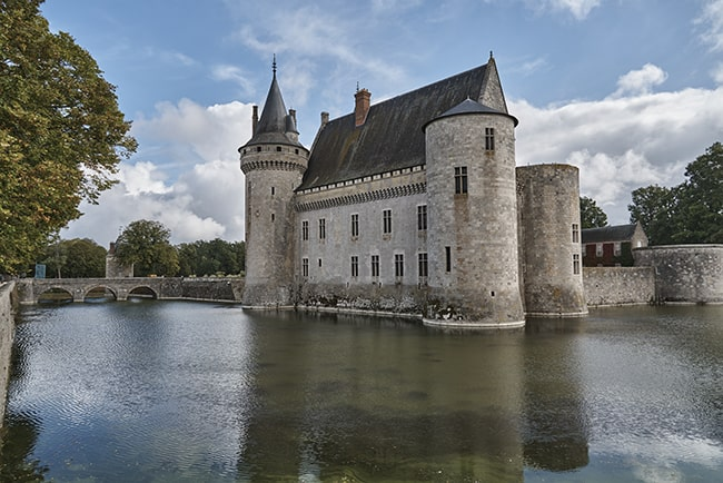 [Château de Sully-sur-Loire and its reflection in the surrounding moat. Photo: Dawn Dailey