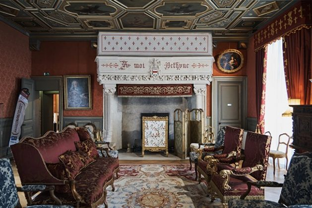 The Great Room with its ornate fireplace and painted ceiling.