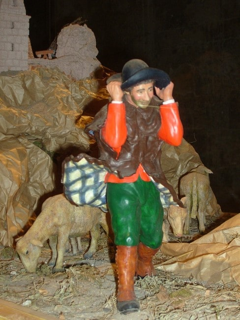 A traditional Provençal santon, or Christmas creche figure, from Arles, facing the mistral