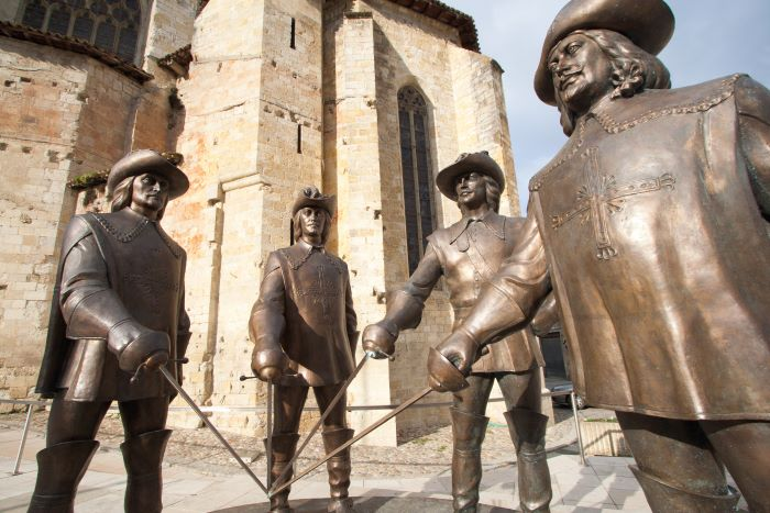 Gothic cathedral of Saint-Pierre, the Armagnac Museum, and statue of the four Musketeers