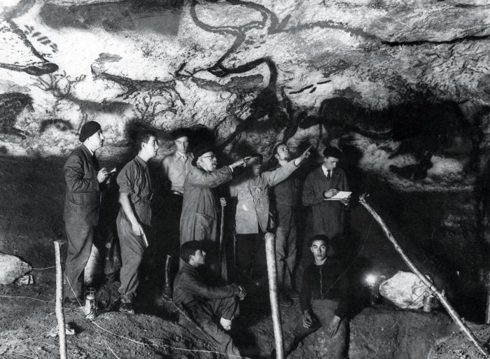Marcel Ravidat, sitting front right, discovered the Lascaux cave paintings when his dog disappeared down a hole, to the amazement of experts around the world