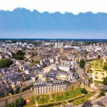 An aerial view of Vannes, overlooking its fortified city walls and lawns with floral design